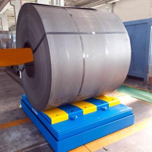 Pesa industriale per coil in funzione